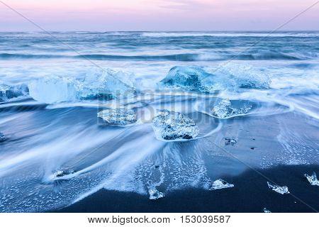 Iceberg beach at Vatnajokull Glacier Jokulsarlon Iceland sunrise
