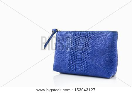 Blue leather cosmetic bag on white background.