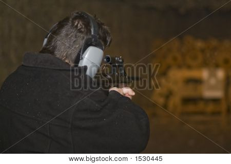 Man, Aiming An Attack Rifle To Target