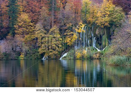 Autumn landscape and small waterfall