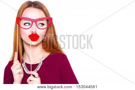 Surprised Funny Woman holding Glasses and red lips on stick, Smart and Beauty concept. Joyful young woman ready for party, isolated on white background. Humor costume