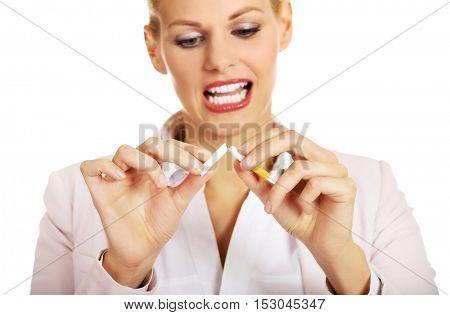 Smile business woman breaking a cigarette