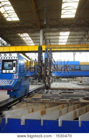 Machine For Cutting And Slitting Steel Sheet