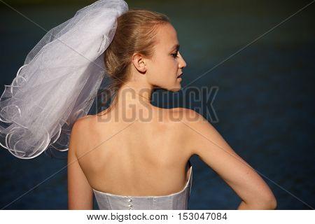 Stunning classical brides with veil   profile outdoors