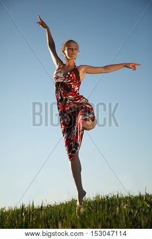 Girl is jumping high over the field