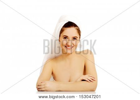 Relaxed woman with towel on head