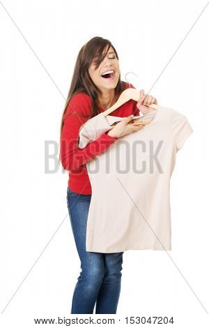 Happy woman with a new shirt.