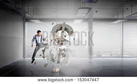 Businessman destroying dollar . Mixed media