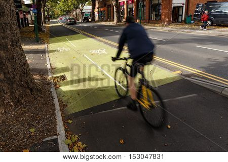 NOTTINGHAM ENGLAND - OCTOBER 19: Male cyclist using cycle lane along Castle Boulevard Nottingham England. In Nottingham England. On 19th October 2016.