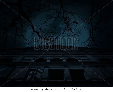 Old ancient castle with dead tree over moon and cloudy sky Spooky background Halloween concept