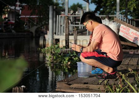 Bangkok ,Thailand-October 1,Buddhists release fish and turtles back to the river in Buddhist worship way ,bring to respect belief for happy life on October 1,2016 in Bangkok,Thailand.Selective focus.