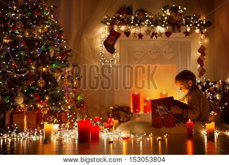 Child Opening Christmas Present Kid Looking to Light Gift Box Night Room Xmas Tree and Fireplace