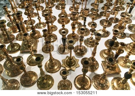 Lots and lots of candle holders made of brass