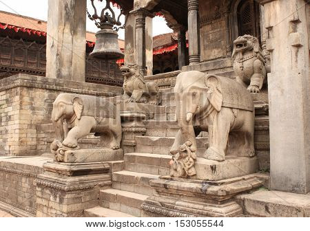 Ancient stone statue of elephants and dogs on steps in Bhaktapur, Kathmandu valley, Nepal. UNESCO World Heritage Site