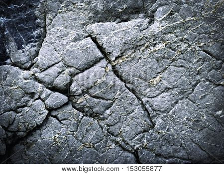 abstract background or texture dark stone with grooves