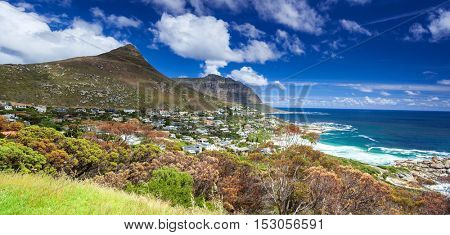 Cape Town panoramic landscape, Camps Bay and Lion's Head mountain, beautiful coastal city, famous touristic place, South Africa