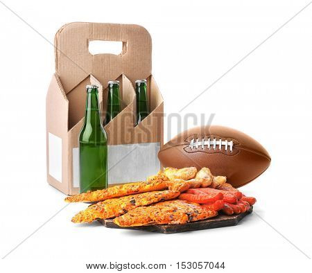 Beer with snacks and rugby ball on white background
