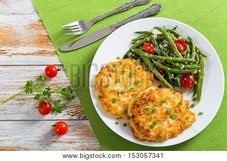 Portion Of Chicken Meat Fritters Served With Stew Green Beans