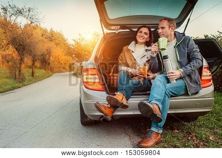 Young couple has a lunch during their auto travel