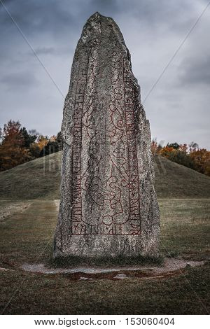 Twelve hundered year old rune stone located at a large burial ground in Sweden.