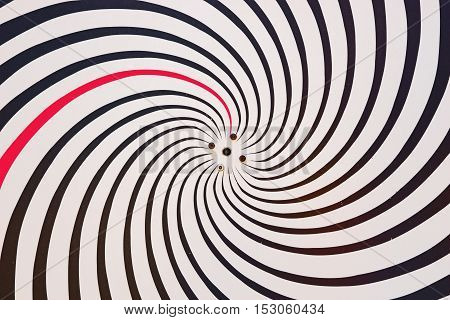 Hypnotize background. Swirling radial pattern black and white background
