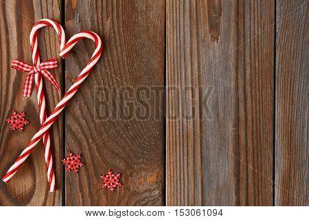 Christmas cane decoration on wooden background