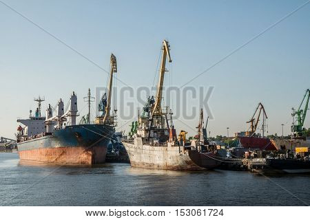 cargo vessels in commercial harbor, baltic sea