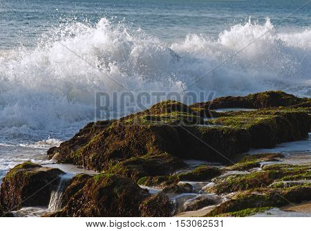 waves crashing on the rocks and splash