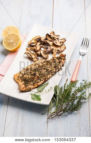 roasted fish fillet with mixed herbs and grilled mushroom