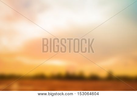 Natural background blurring.warm colors and bright sun light. bokeh background or Christmas background.Green Energy.warm sky sunny color green light patterns plain abstract flare evening clouds blur