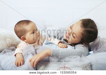 children sisters lie. The concept of family and childhood.