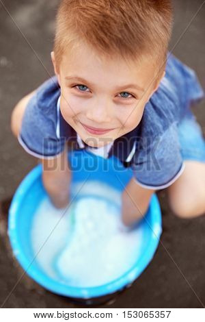 Cute boy with bucket and sponge, closeup