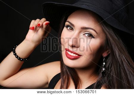 Portrait of sensual lady with red lips on dark background