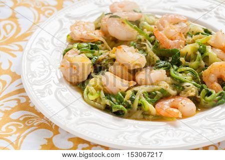 Low carb zucchini spaghetti with shrimp on a tabble