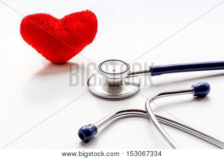 stethoscope on a white background with plush red heart