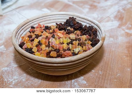 Sweet Candied Fruit closeup candied fruit in a bowl on wooden table floured dried fruit slices
