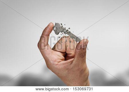 Key between fingers . Mixed media