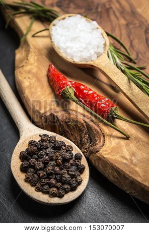 Chili With Black Pepper And Salt On Rustic Wooden Table.