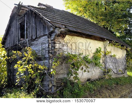 House on the top of hill from travel to Slovenia: forests, mountains, autumn background,