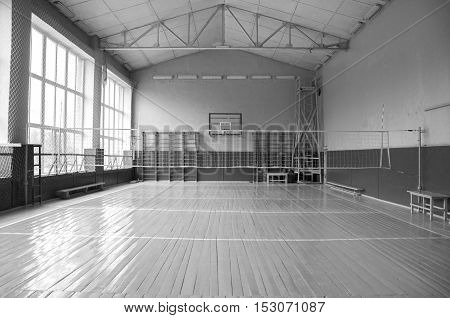 School gym indoor. School sport arena. Black and white photography