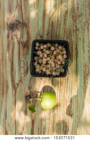 white grape or currant berry with apple fruit green color with healthy vitamins on wooden or wood table