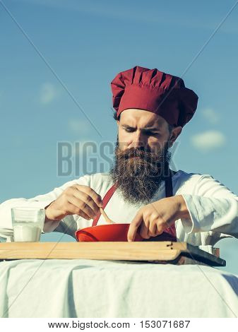 Man Chef Mixing Up Ingredients
