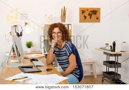 Successful middle aged woman at her office