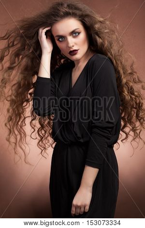 Woman With Blowing Hairstyle And Perfect Make Up