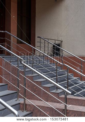 staircase with iron railing in the modern house