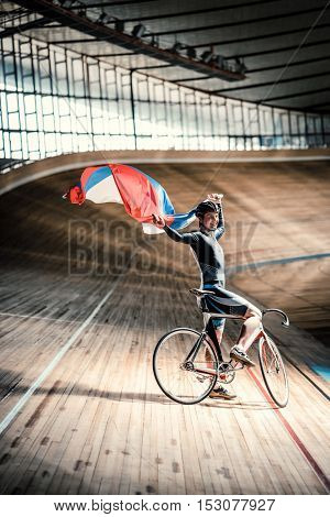 Young cyclist with a Russian flag