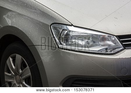 Vehicle With Rain Droplets On Wheel Tyre And Bonnet