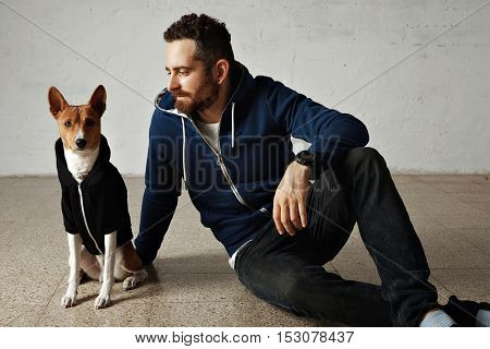 Man And Dog In Matching Hoodies