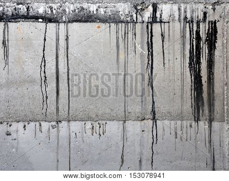 Industrial background. Texture of monolithic concrete foundation with traces of bitumen waterproofing.