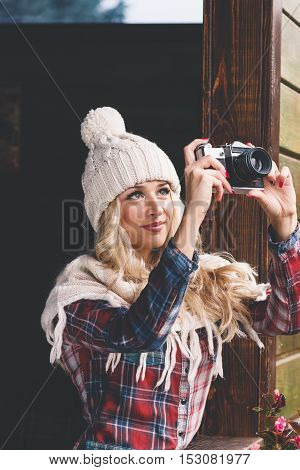 Young Attractive Woman In The Cafe With Camera